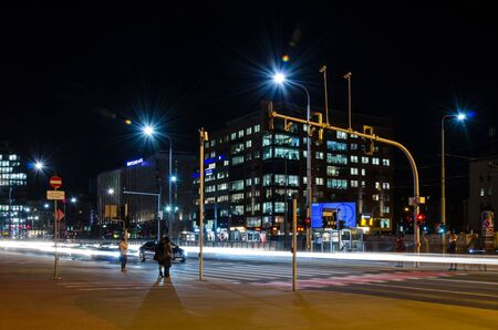 POZNAN  POLAND - 2019: Night cityscape at a busy intersection in the center