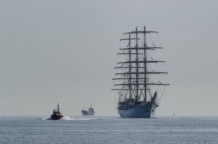 SHIPS AT SEA - Sailing vessel and motorboat on the waterway Stok Fotoğraf