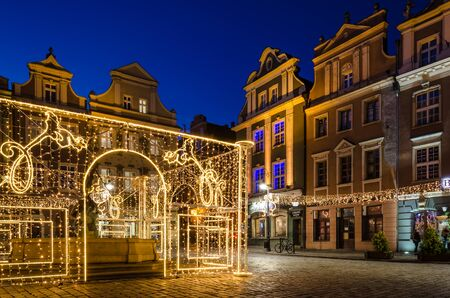 POZNAN  POLAND - 2019: Historic tenements and Christmas decorations on the town hall