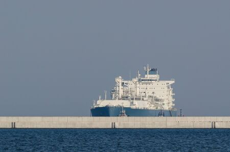 LNG TANKER - The gas supply ship is sailing at the port breakwaters