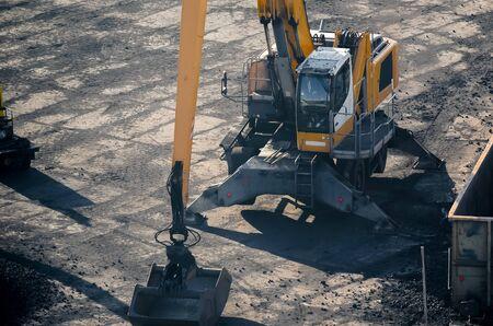RELOADING EXCAVATOR - Machine on a coal storage yard