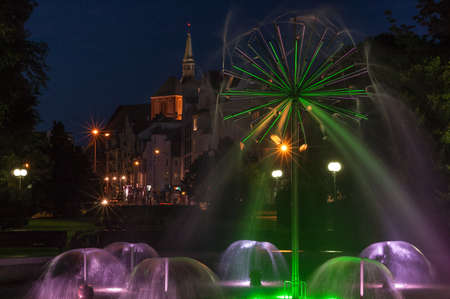 KOLOBRZEG, WEST POMERANIAN / POLAND - 2018; Night at the colorful fountain