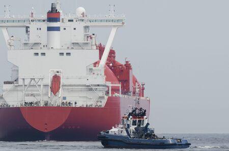 LNG TANKER - Red ship flows in tug insurance