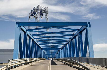 BRIDGE - Picturesque classic steel structure on the river Stock fotó