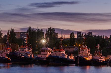 SZCZECIN, WEST POMERANIAN / POLAND - 2020: Tugs moored to the sea port quay Sajtókép