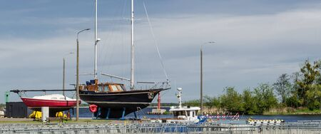 IN THE MARINA - Yachts on the harbor quay before the start of the sailing season
