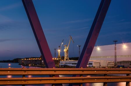 SHIPBUILDING INDUSTRY - Dock at the shipyard and port cranes on quays
