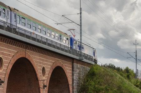 KARLINO, WEST POEMARANIAN / POLAND - 2020: The express train travels through the viaduct along the railway route Sajtókép