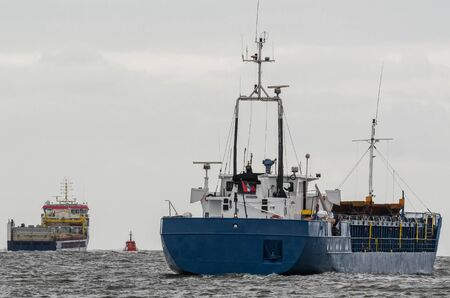 MARITIME TRANSPORT - Freighters are sailing on a sea voyage