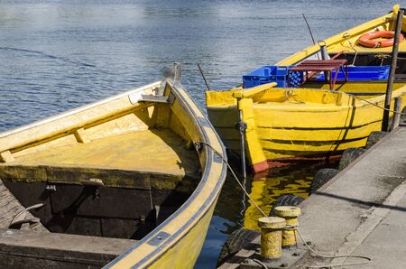 A SMALL FISHING PORT - Traditional fishing boats moored at the quay