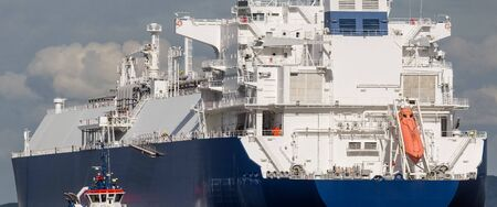 MARITIME TRANSPORT - The LNG tanker maneuvers for mooring at gas port terminal