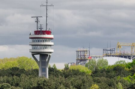 MARITIME TRANSPORT - Marine traffic control tower on the background of LNG Terminal