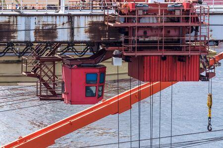 PORT DOCK CRANE - Unloading the ship at the bulk cargo terminal at the seaport