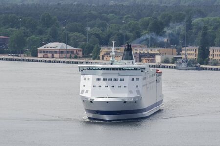 PASSENGER FERRY - The ship sails from port on a sea voyage