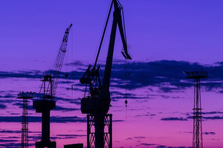 PORT CRANE - A device for moving heavy loads in the port and shipyard at sunrise
