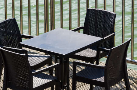 A SEASIDE CAFE - Tables for a seaside restaurant on the promenade with a view to the sea Reklamní fotografie