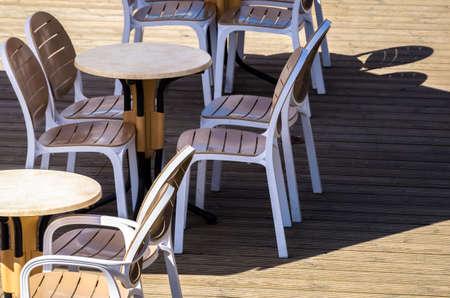 A CAFE IN THE SUNSHINE - Tables in the restaurant garden Reklamní fotografie