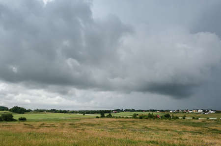 CLOUDY SUMMER - Rainy weather over the fields and the village Stock fotó