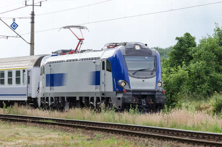 EXPRESS TRAIN - Locomotive with a composition of passenger wagons on the route