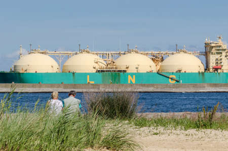 SWINOUJSCIE, WEST POMERANIAN / POLAND - 2020: The LNG carrier SOKOTO unloads gas at the terminal in the seaport