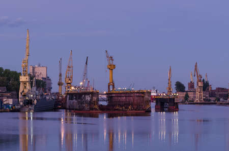 SHIPYARD - Harbor cranes and repair dock at dawn