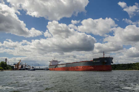 SWINOUJSCIE, WEST POMERANIAN / POLAND - 2020: Bulk carrier sails from port to the sea