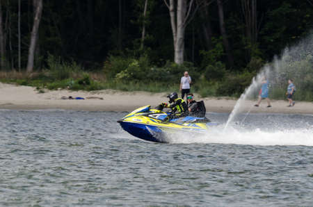SWINOUJSCIE, WEST POMERANIAN / POLAND - 2020: A vacationers is swimming a jet ski on the fairway