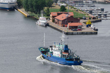 BUOY LAYING VESSEL - Auxiliary ship goes to port