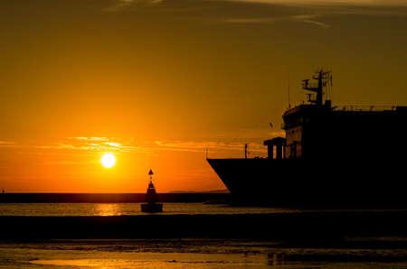 PASSENGER FERRY - Sunrise over a ship going on a sea cruise Standard-Bild