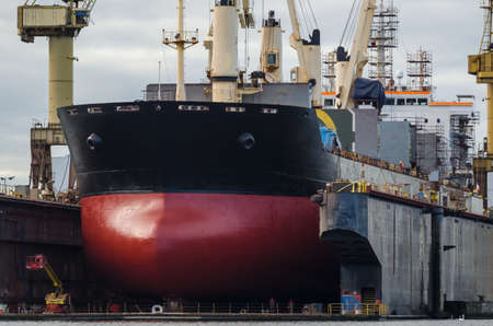 SHIPYARD - Merchant vessel under dry repair dock