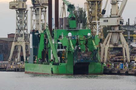 DREDGER - A specialized ship at the port wharf
