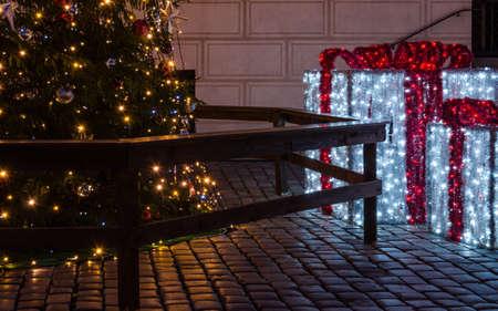 CHRISTMAS TIME - Shiny presents and a Christmas tree on the town hall square