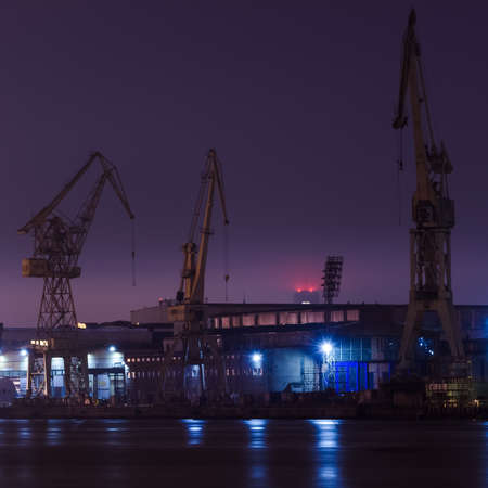 SHIPYARD - Buildings, cranes and industrial infrastructure at night