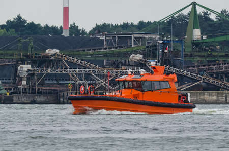 PILOT BOAT - A modern motor boat maneuvers in the port