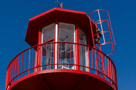 BEACON - red navigational sign on the sea waterway