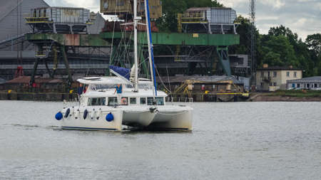 SWINOUJSCIE, WEST POMERANIAN - POLAND - 2020: Sailors on the yacht are going to the port