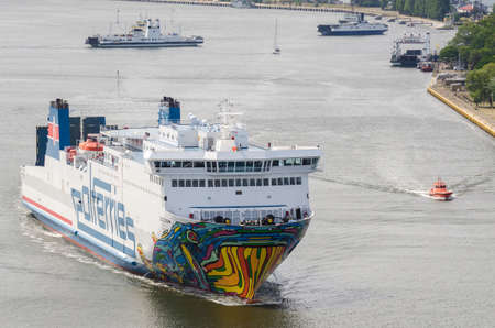 SWINOUJSCIE, WEST POMERANIAN - POLAND - 2020: The passenger ferry sails to the terminal in the seaport