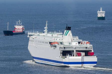 MARITIME TRANSPORT - Passenger ferry and freighters go at sea 免版税图像