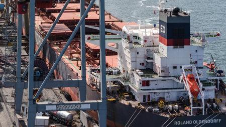 SWINOUJSCIE, WEST POMERANIAN - POLAND - 2020: Bulk carrier unloading at the sea port terminal