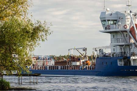 MARITIME TRANSPORT - A merchant vessel sails to the sea