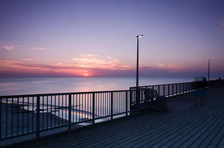 SUNSET OVER THE SEASHORE - Evening walk to the pier Standard-Bild