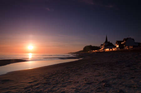 SUNRISE OVER THE SEASHORE - Resorts and hotels in front of the beach