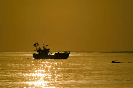 FISHING BOAT - A small ship at sea in the sunny morning Standard-Bild