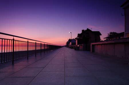 SUNRISE OVER THE SEASHORE - A colorful morning on the promenade