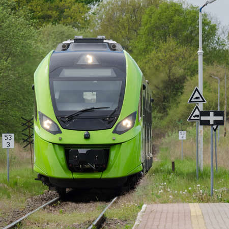 MODERNTRAIN - A modern hybrid traction unit enters a small village station