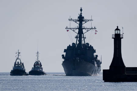 WARSHIP - Guided missile destroyer sails to the port