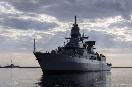 WARSHIP - Guided missile frigate flows to the port