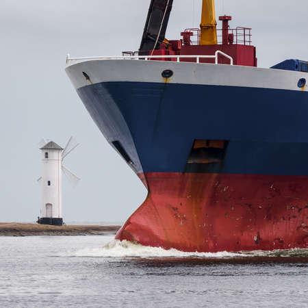 MERCHANT VESSEL - Freighter sails to sea port