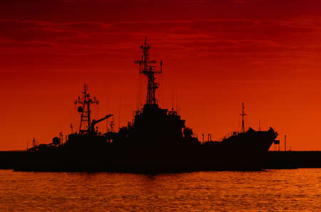 WARSHIPS - A fiery sunrise over the naval base
