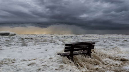 STORMY SEA - Benches on the seashore are flooded with foamy waves